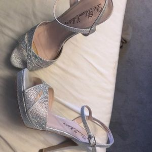 Brand new, never worn silver heels